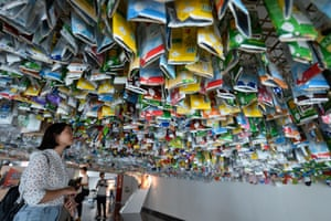 Visitors view an installation made from plastic, cans and containers in Hanoi, Vietnam