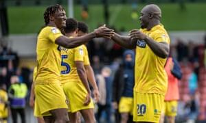 Adebayo Akinfenwa, right, celebrates Wycombe's win at Rochdale with Anthony Stewart.