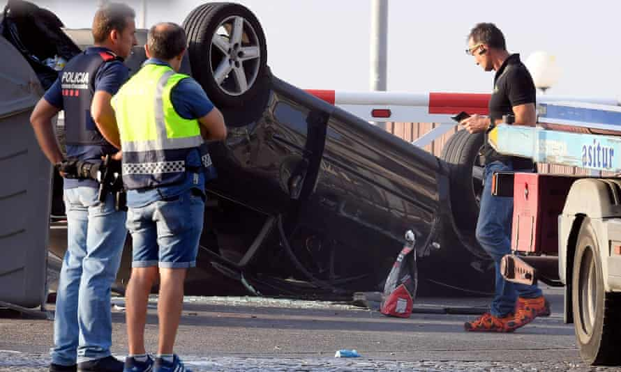 Police check a car involved in the attack in Cambrils.