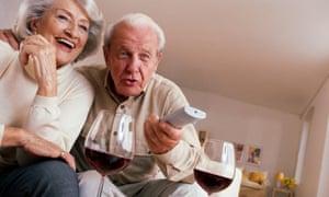 Elderly couple enjoying a glass of wine.
