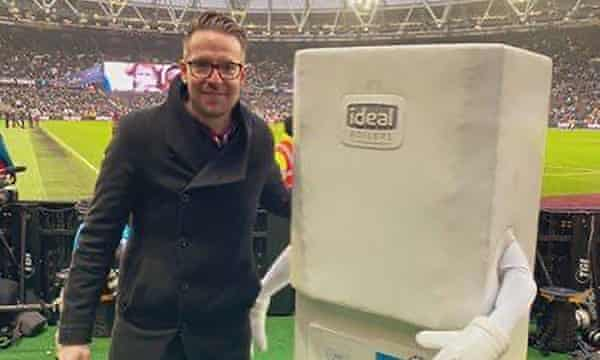 West Ham fan Chris Scull alongside West Brom mascot Boiler Man, before the sides met in the FA Cup at the London Stadium last January.