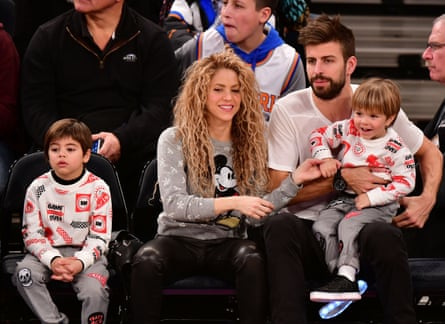 Keeping the balance … Shakira and Gerard Piqué, with their sons Milan, left, and Sasha at a New York basketball game in 2017.