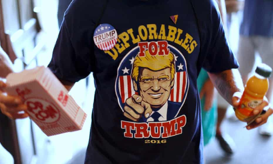 A supporter of the Republican presidential nominee, Donald Trump, returns from the concession stand with popcorn at a Trump rally in Toledo, Ohio, on 21 September.