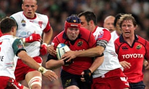 Munster captain Anthony Foley driving through the Biarritz opposition during the Heineken Cup final in Cardiff in 2006.