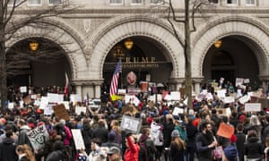 Demonstrators outside Trump Hotel International in Washington DC in January 2017 protest President Trump's executive order barring citizens of Iraq, Syria, Iran, Sudan, Libya, Somalia and Yemen.