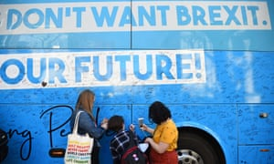 Young people signing a bus belonging to a youth movement for a 'people's vote', nearly three years after the referendum