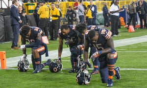 Chicago Bears players Adrian Amos, DeAndre Houston-Carson, Deon Bush, and Josh Bellamy kneel in the end zone before the national anthem at Lambeau Field.