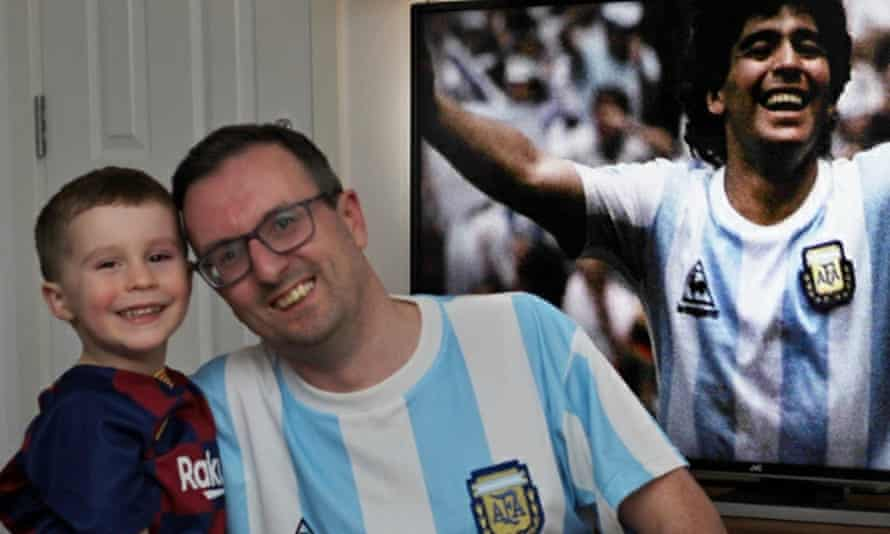 James Williamson, who has been an avid fan of Maradona's since he was a young boy, and his own son Jamie, watching Maradona on the TV.