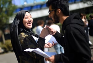 Mona Abou Dahech (left) fist bumps a fellow student at the City academy in Hackney