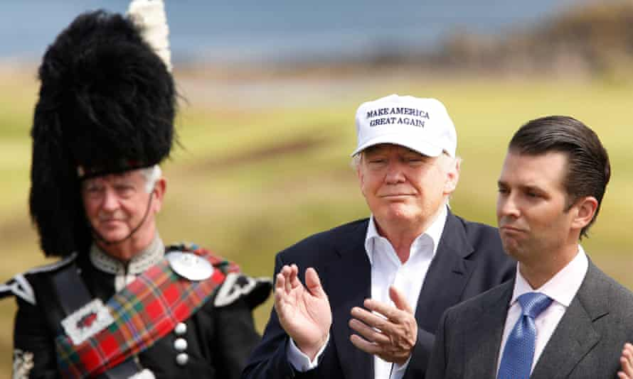 Donald Trump officially opens his Ayrshire hotel and golf resort, with his son, Donald Jr, by his side.