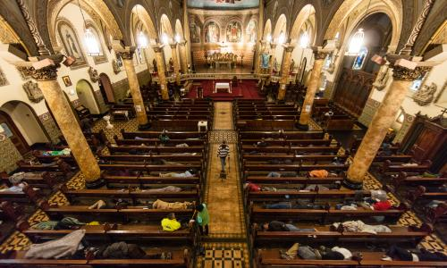 Homeless people sleep in the pews at St Boniface Catholic Church as part of the Gubbio Project in San Francisco.