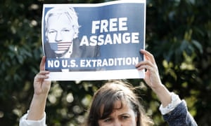 Spanish MEP Ana Miranda holds up a placard in support of Julian Assange outside Belmarsh prison.