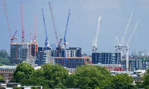 Construction cranes over a building complex in London