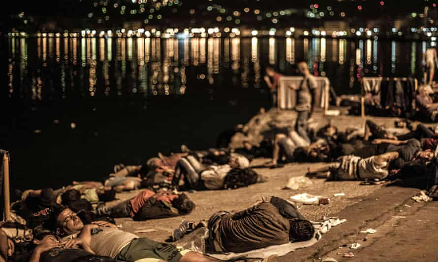 Migrants on the quayside in Lesbos.