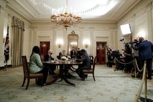 Joe Biden participates in a roundtable discussion on his $1.9tn coronavirus aid bill.