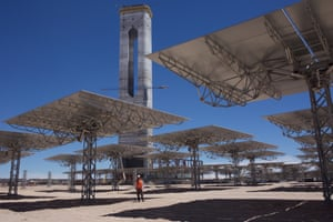 Roberto Herrera, the business development manager of Abengoa, stands below the solar mirrors that radiate for more than 1km across the ground and reflect the sunlight back to the tower.