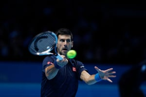 Djokovic returns with a backhand.