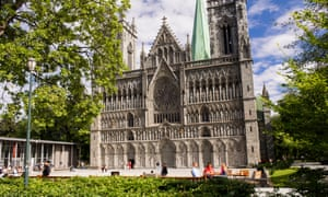 Family outside Nidaros Cathedral, Trondheim, Norway