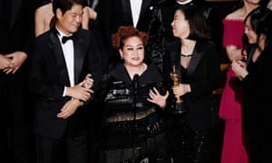 'I love the way he talks, the way he walks' … Parasite producer Miky Lee on stage at the Academy Awards.