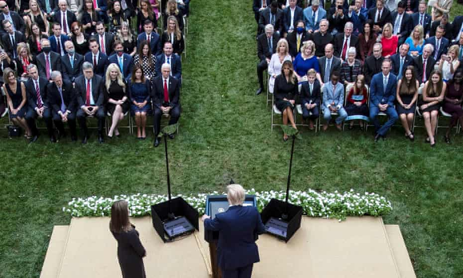 People are seated closely together at a White House event in September last year.