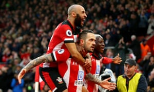 Danny Ings celebrates with Nathan Redmond and  Moussa Djenepo after scoring what proved the only goal as Southampton beat Tottenham 1-0