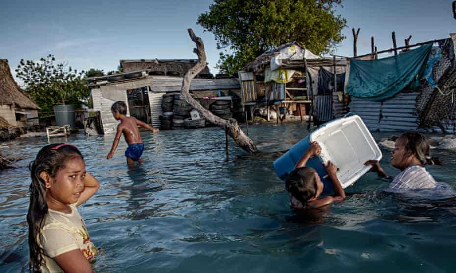 The people of Kiribati are under pressure to relocate due to sea-level rise.
