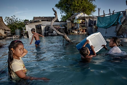 People in the Kiribati village of Eita after flooding. They are under pressure to relocate due to sea level rise.
