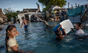 The people of Kiribati are under pressure to relocate due to sea-level rise. Flooding in the village of Eita on the Tarawa atoll is increasingly frequent.
