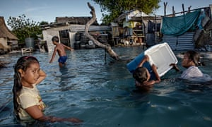 Rising sea levels – a direct effect of climate change through global human activity – affecting Eita village, in the Pacific Ocean republic of Kiribati.