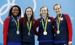 The women's freestyle relay team celebrate their silver medal.