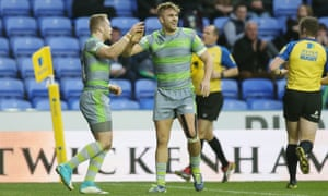 Newcastle's Alex Tait, left, celebrates scoring one of his two tries against London Irish