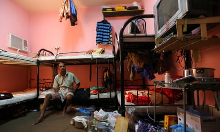 An Indian labourer sits in his room at a camp housing foreign workers in Doha.