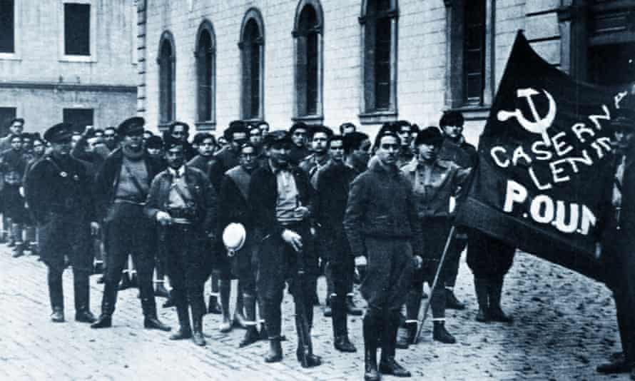The Poum militia in Barcelona 1936 with Orwell in the background; he describes several days and nights spent defending its headquarters from the roof of the nearby Poliorama theatre in 1937.