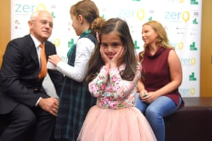 Australian Prime Minister Malcolm Turnbull is greeted by 6-year-old cancer patient Lulu Demetriou (centre) and fellow patient 7-year-old Georgia Burgess (back) during his visit to the Lowy Cancer Research Centre at the University of New South Wales in Randwick, Sydney, Tuesday, May, 31, 2016.