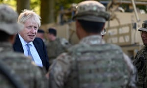 Boris Johnson speaking to Ghurkas during a visit to military personnel on Salisbury plain training area.