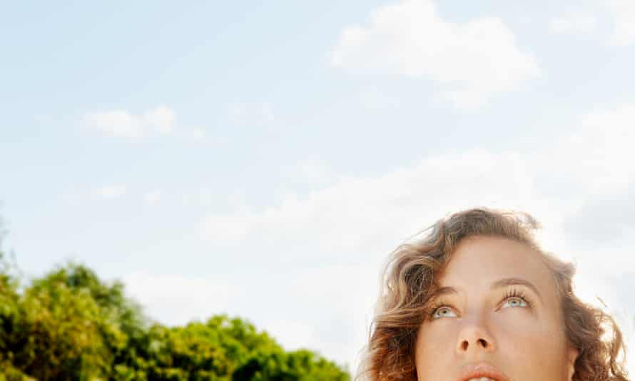 woman looks up on sunny day