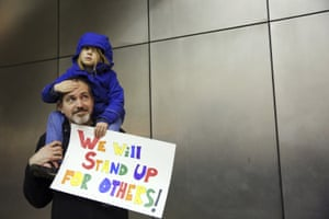 Mark Sernett, Wade SernettMatt Sernett holds his daughter Wade, 5, atop his shoulders, as more than 1,000 people gather at Seattle-Tacoma International Airport, to protest President Donald Trump's order that restricts immigration to the U.S., Saturday, Jan. 28, 2017, in Seattle. (Genna Martin/seattlepi.com via AP)