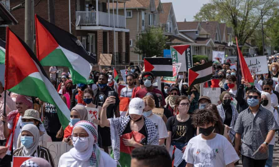 Protesters march through neighborhoods near a Ford Motor Company plant in Dearborn, Michigan, where Joe Biden was touring on 18 May.