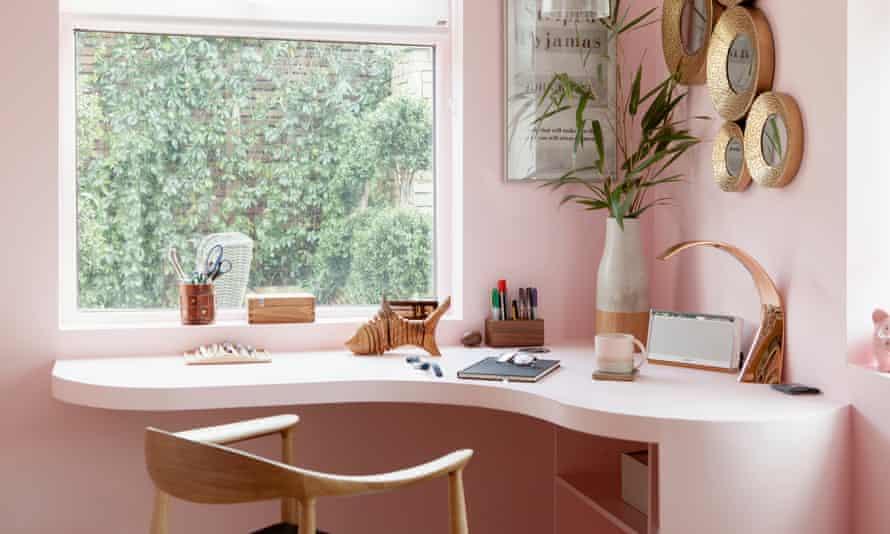 The blush-pink corner desk and walls