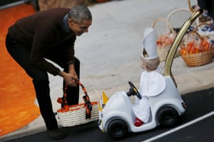 President Obama receives a child dressed as Pope Francis on the South Lawn of the White House