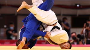 Lukhumi Chkhvimiani of Georgia in action against Naohisa Takato of Japan in the mens judo 60kg quarter-final.