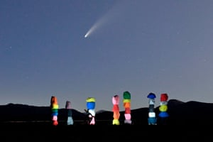 Neowise above the Seven Magic Mountains installation in Nevada by the artist Ugo Rondinone