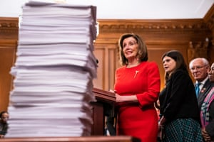 Nancy Pelosi gestures to a stack of bills the Democratic-controlled House of Representatives under her leadership has sent to the Senate in 2019.