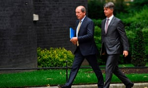 Nestle's Belgian chairman Paul Bulcke (left) and CEO and chairman of BMW Harald Kruger arrive at Downing Street