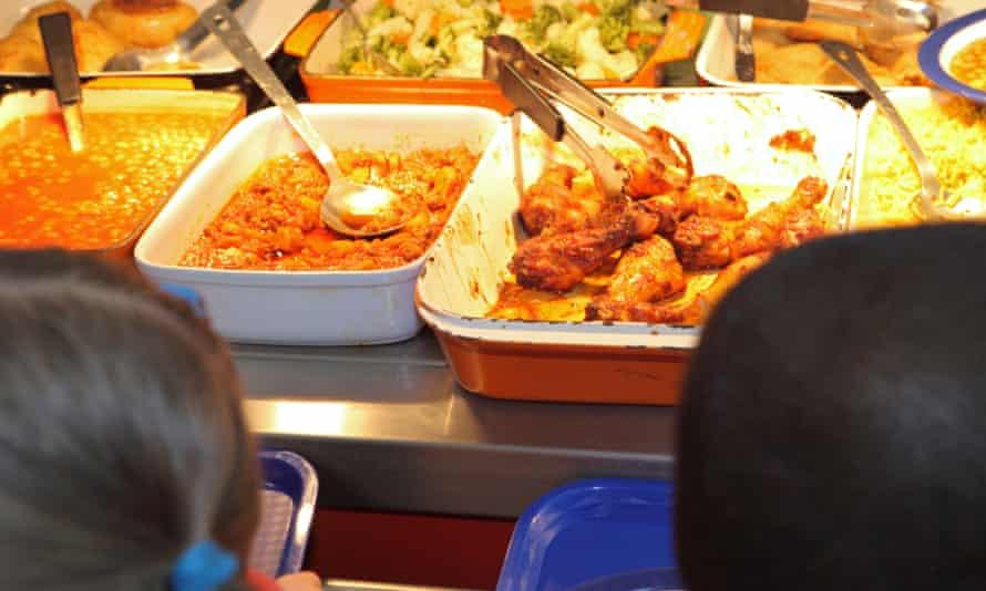 Schoolchildren queuing for a hot lunch.