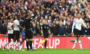 Chris Smalling of Manchester United is shown a red card by Referee Mark Clattenburg.