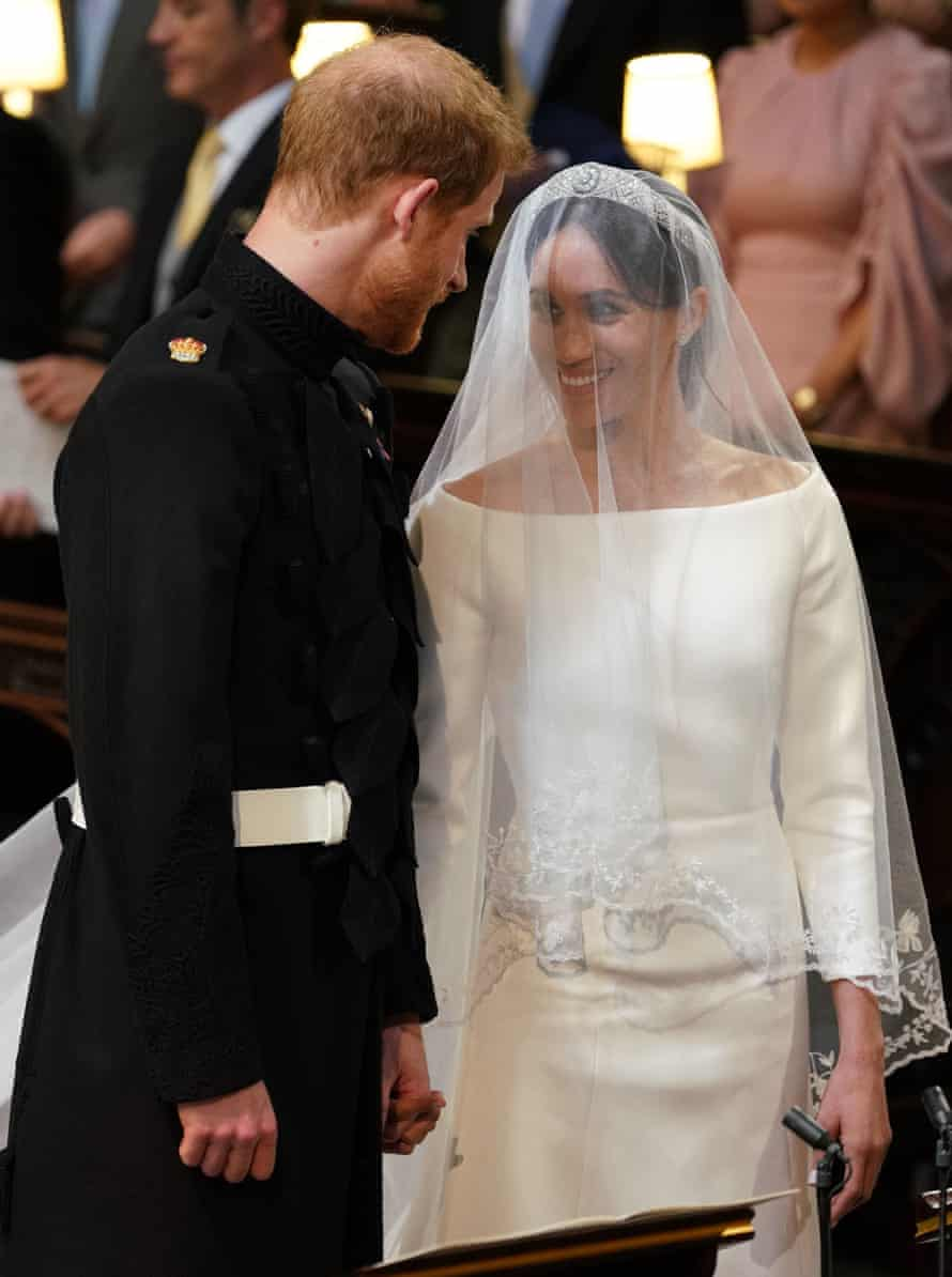 Prince Harry and Meghan Markle stand together at the altar in St George's Chapel, Windsor Castle.