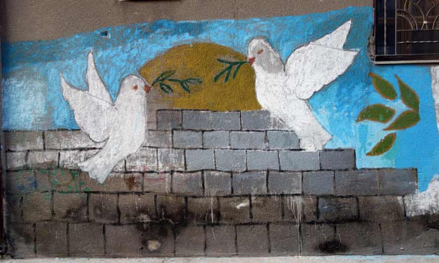 A plea for peace painted on the wall in Homs