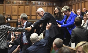 The new Speaker of the House, Lindsay Hoyle, centre, is led by MPs to his seat in the Commons.