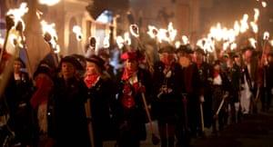 Participants parade through the town